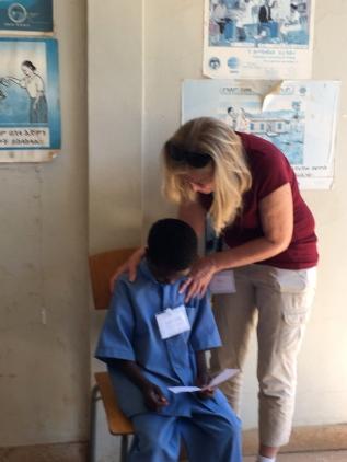 Teri prays over each child.