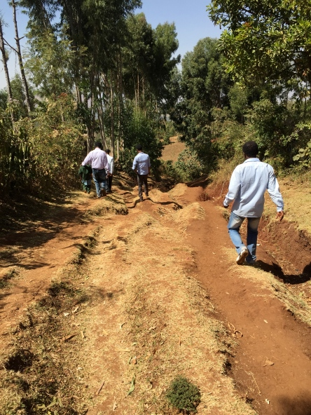 Hiking to my sponsor child's home.  He's the little one on the far left of the picture, wearing his green school uniform.